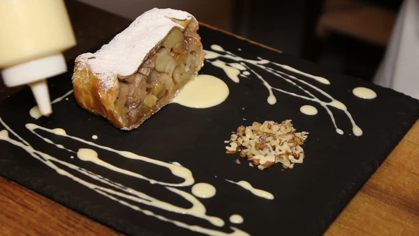 chef decorate strudel with apples