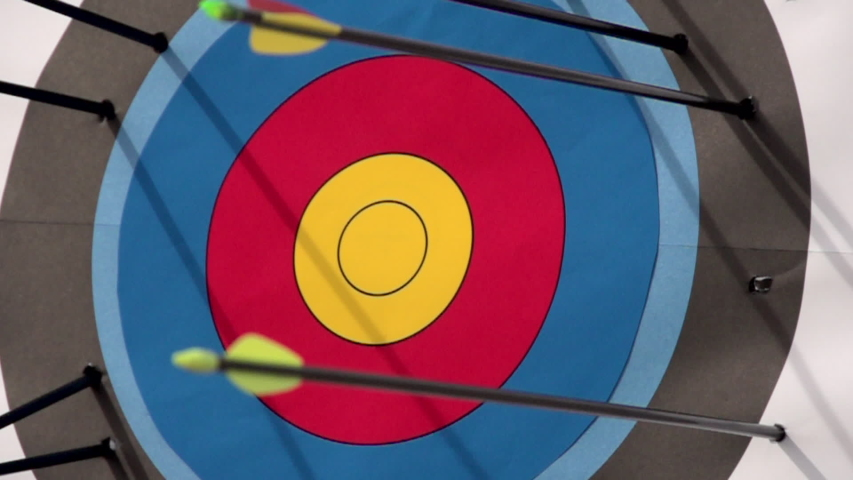 An arrow hitting the center of a target. - Slow Motion - Model Released - filmed at 480 fps