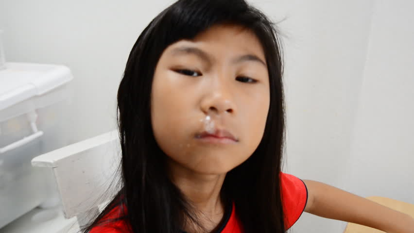 Tiny Asian Girl With Braces