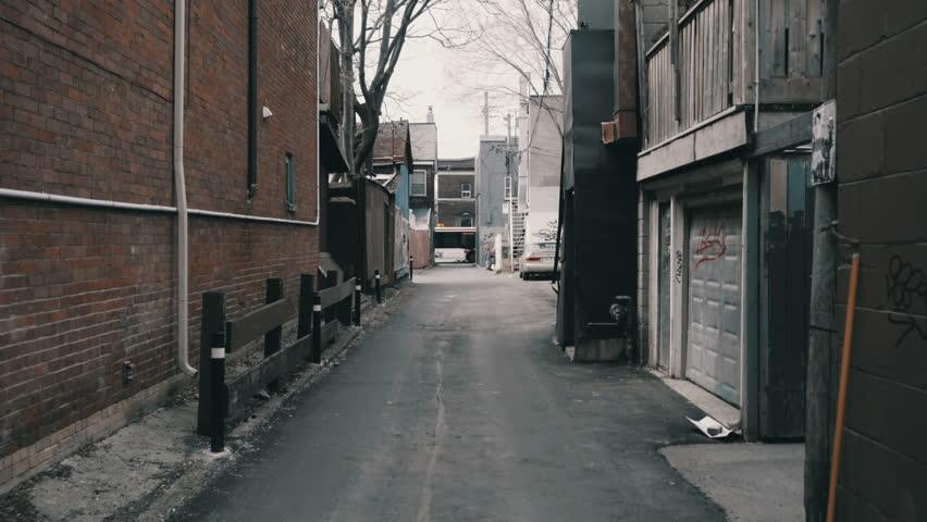 Establishing shot of a back alleyway