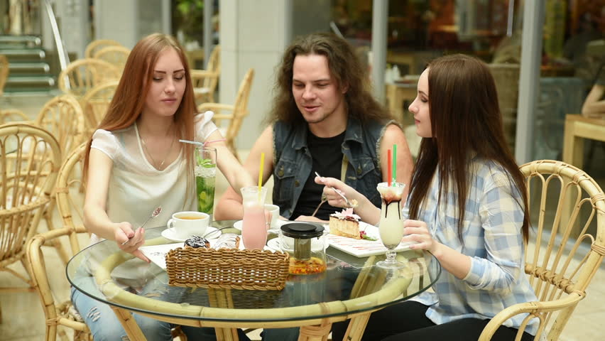 Happy friends meeting and drinking tea or coffee at cafe | Shutterstock HD Video #16119712