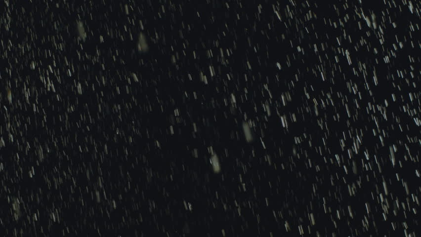 Rain drops falling on black, background, backlit,200fps,loopable.2K (2048X1152) 16:9 background of heavy hard rain falling in 200p slow motion conformed to 25p.Shot on Arri Amira.