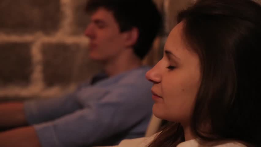 Guy with a girl meditating.   Shutterstock HD Video #16136032