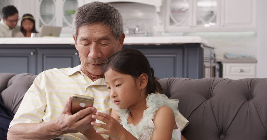 Grandfather And Granddaughter Using Mobile Phone Shot On R3D | Shutterstock HD Video #16145959