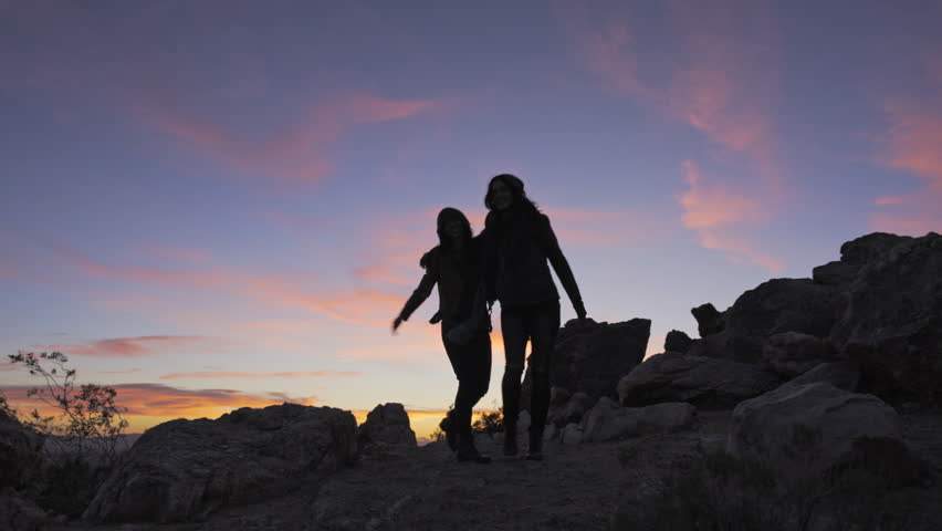 April 2016 - Los Angeles: Two females hiking in the desert at sunset #16156399