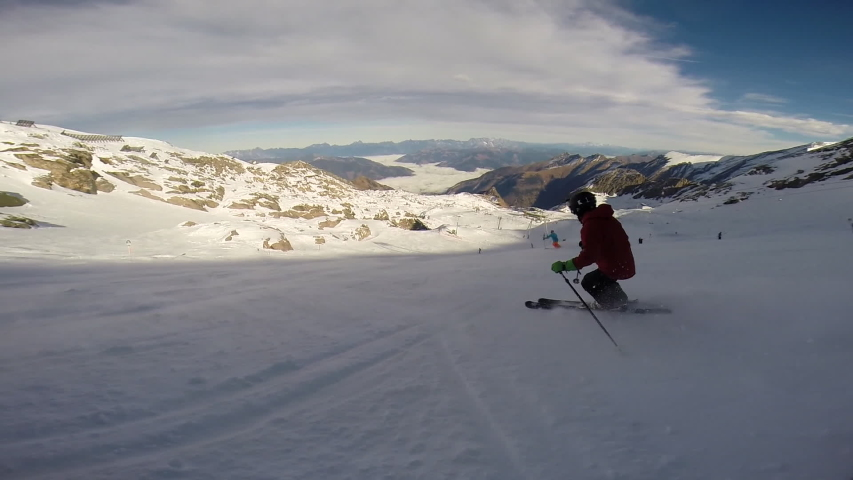 Young man skiing down a snow covered mountain. - Slow Motion - Model Released | Shutterstock HD Video #16186162