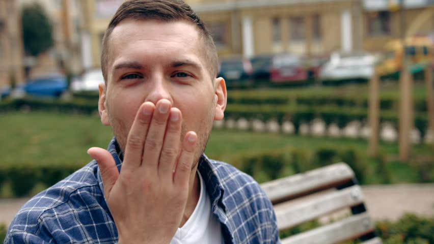 Portrait of young man sending a kiss | Shutterstock HD Video #16199026