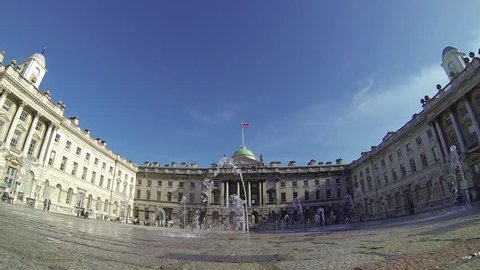 LONDON, UK - APRIL 20, 2016: Footage view of spurting water fountains by Somerset House in London, UK on a sunny day. Ultra wide angle view.