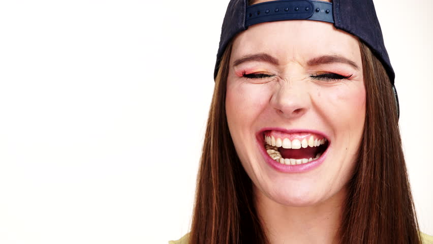 Woman casual style smiling teen girl eating chewing gum fooling around on white background. Youth style. 4K ProRes HQ codec