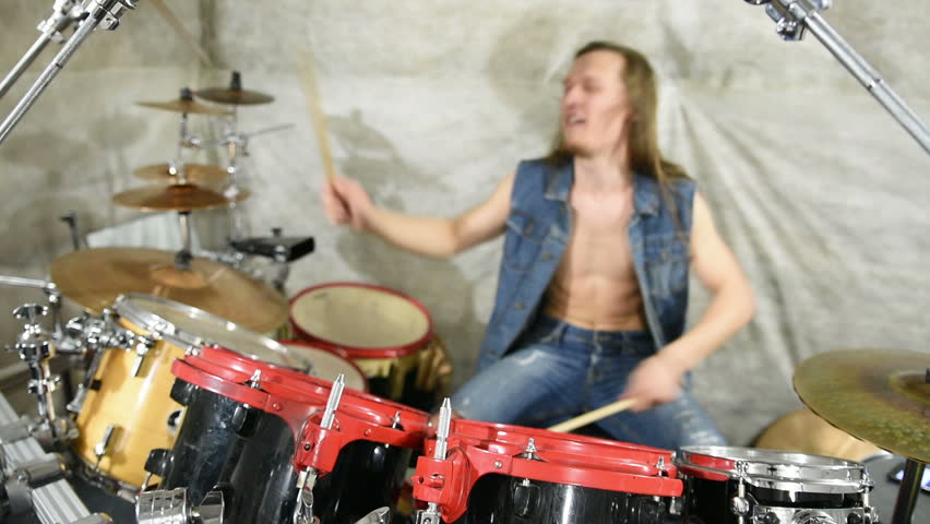 Musician playing drums on stage, rock music    Shutterstock HD Video #16260574