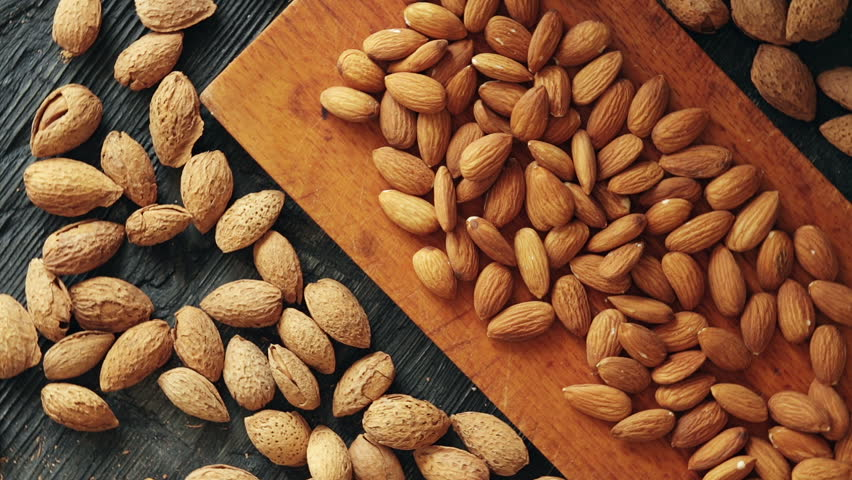 Almonds On Wooden Background. Peeled Stock Footage Video ...