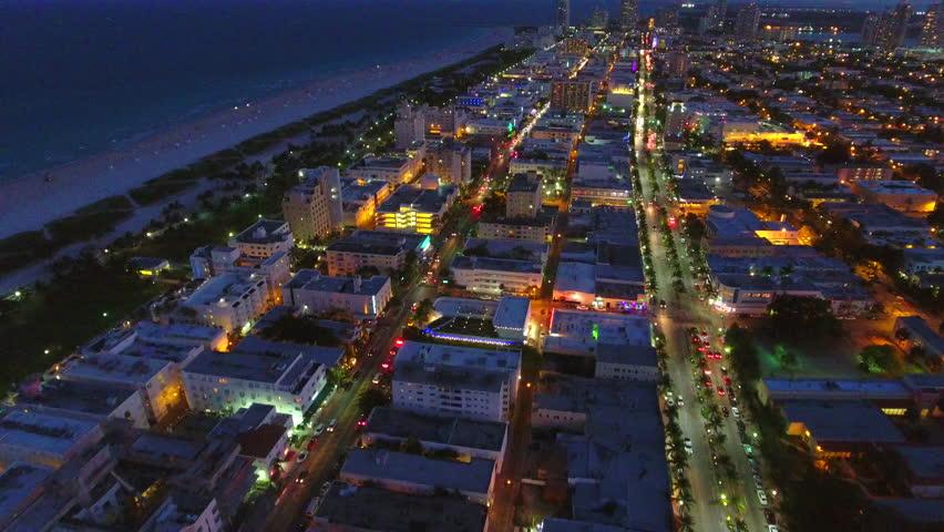Miami lights up at night aerial video