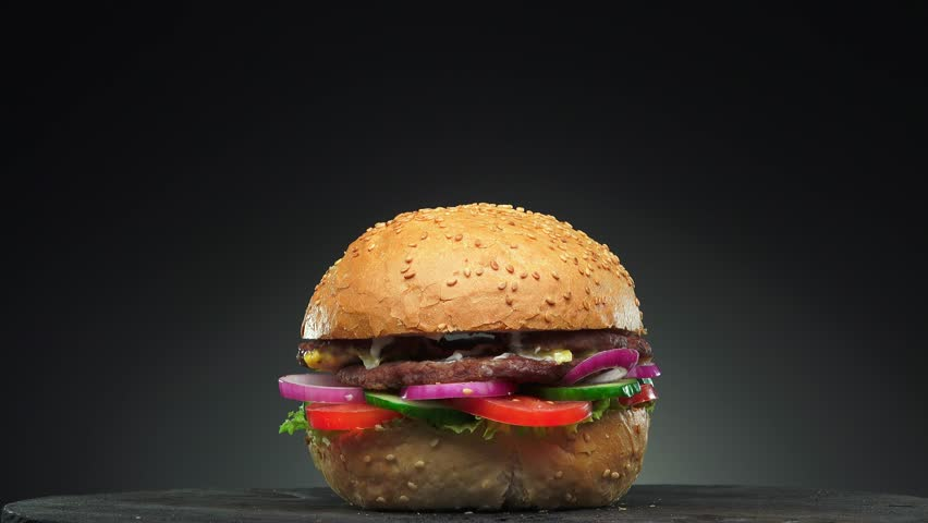 Fresh appetizing hamburger rotating on black background. Seamless loopable shot, 4k. #16297072