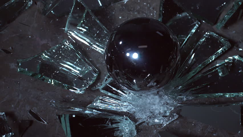 Steel ball falling on a mirror shattering the mirror and bouncing in super slo-motion. | Shutterstock HD Video #16303303