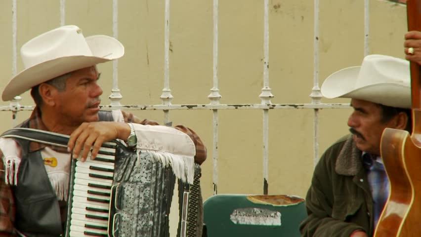 TIJUANA, MEXICO - CIRCA 2008: Musicians chat in downtown Tijuana Mexico. #1631320