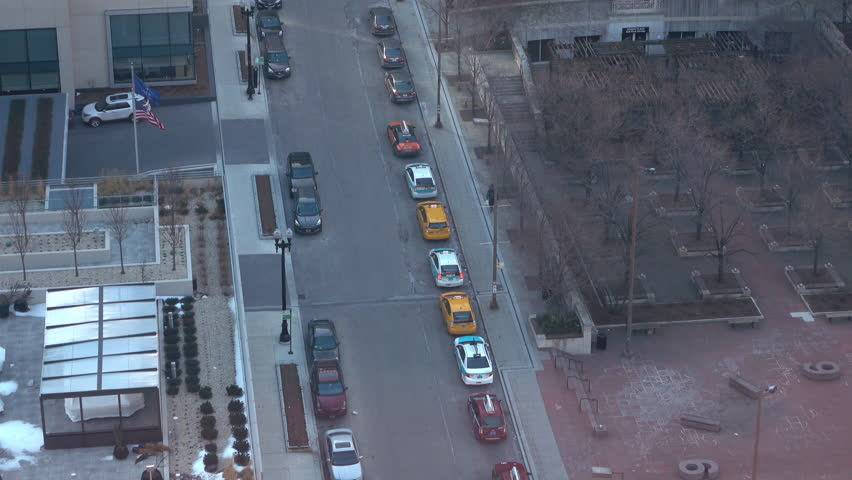 CHICAGO, ILLINOIS - CIRCA 2015: Line of cabs parked on city streets of Chicago, Illinois, taken in 4k/UHD resolution. #16314658