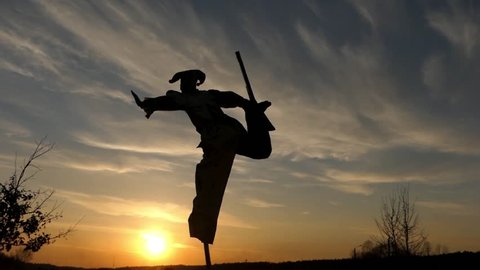Stilt Walker Jumping on One Leg at Sunset. Beautiful Action in Real Time.