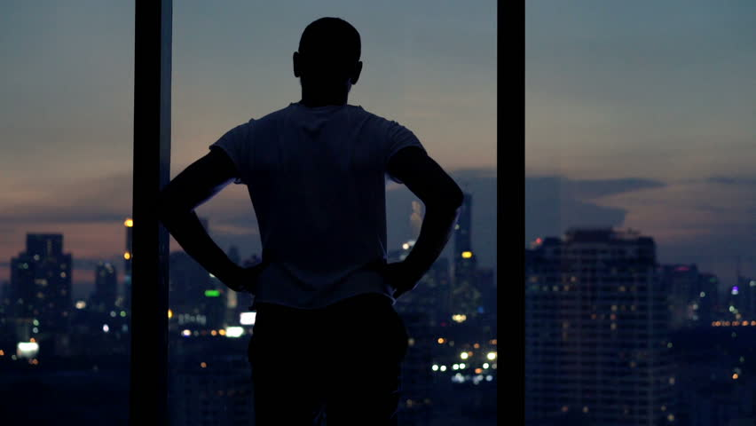 Young man admire view from window at home at night  | Shutterstock HD Video #16318453