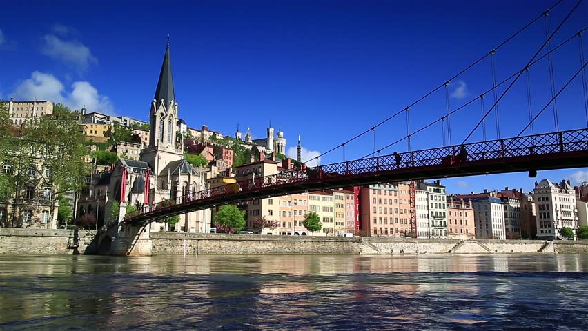 People are walking over the Passerelle Saint-Georges bridge over the Saone river in Lyon, France. | Shutterstock HD Video #16328815
