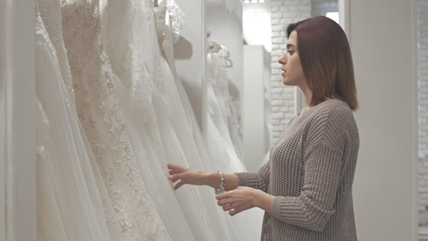 Women having fun during bridal gown fitting in wedding fashion store   Shutterstock HD Video #16345624