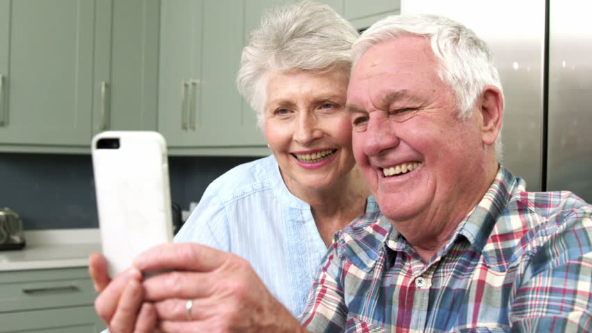 Smiiling old couple taking a selfie with a smartphone | Shutterstock HD Video #16354078