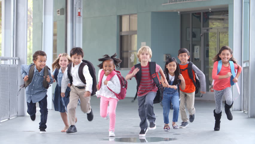 Group of elementary school kids running in a school corridor #16355902
