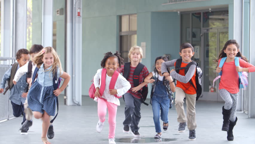Group of elementary school kids running in a school corridor #16355920