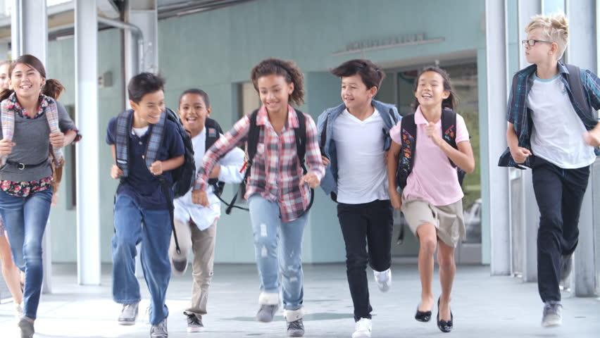 Group of 5th grade school kids running in a school corridor #16356877