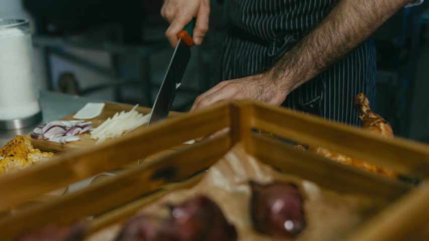 Restaurant Chef preparing ingredients for a salad. 60 FPS slow motion shot. Blackmagic URSA Mini | Shutterstock HD Video #16361386