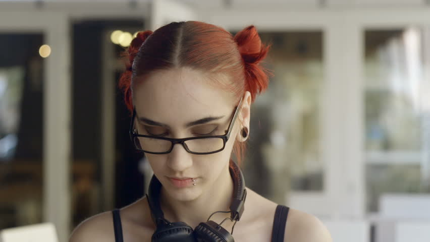Girl with red hair talking on the phone | Shutterstock HD Video #16365550
