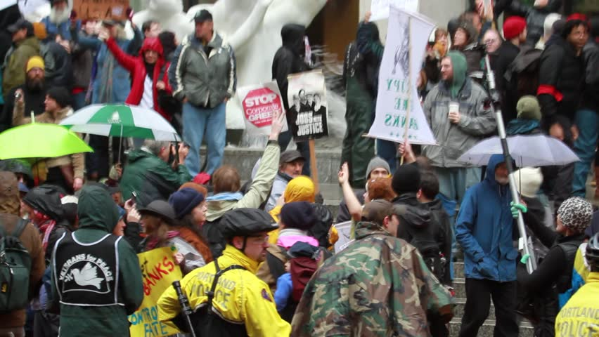 """PORTLAND, OREGON - NOVEMBER 17: Protesters participate in Occupy Portland N17 """"Occupy the Banks"""" rally November 17, 2011 in Portland, Oregon."""