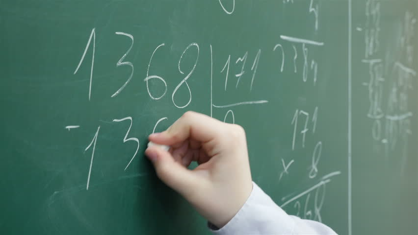 A pupil solves math on the chalkboard at primary school, Close up, Full HD shot   Shutterstock HD Video #16393234