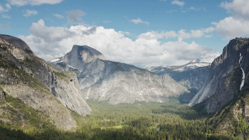 Yosemite Valley with Half Dome and Glacier Point visible in the distance (time-lapse)