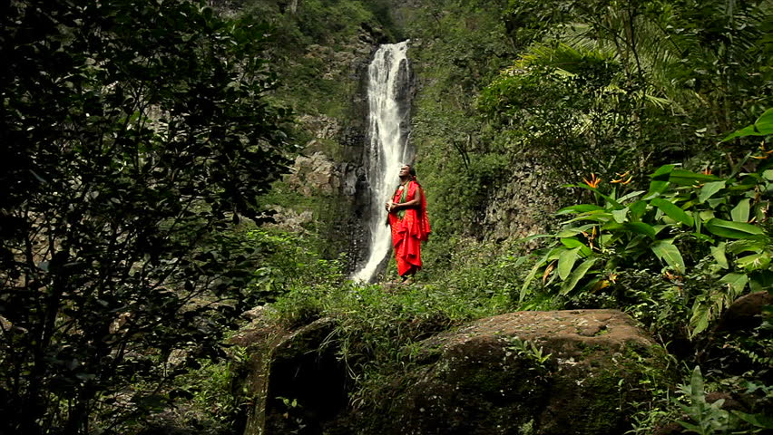HAWAII - CIRCA 2010: Shaman against a waterfall