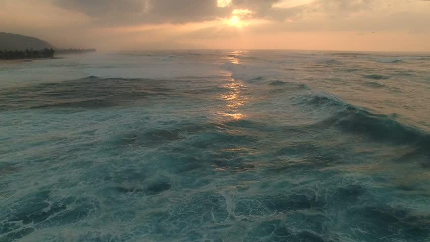 Aerial shot of tropical ocean, sea sunset - Fly over Ocean, Hawaii, Oahu