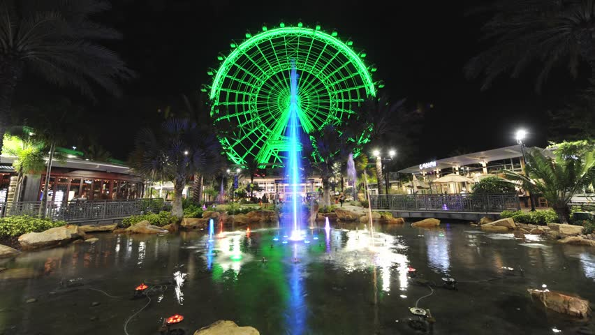 Time-lapse of 'The Orlando Eye' with a colored fountain in front. It is the largest observation wheel on the East Coast of Florida and located on International Drive in Orlando. | Shutterstock HD Video #16467433