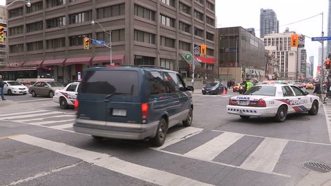 Toronto, Ontario, Canada May 2016: Toronto police officers block off street with police cruiser and bikes
