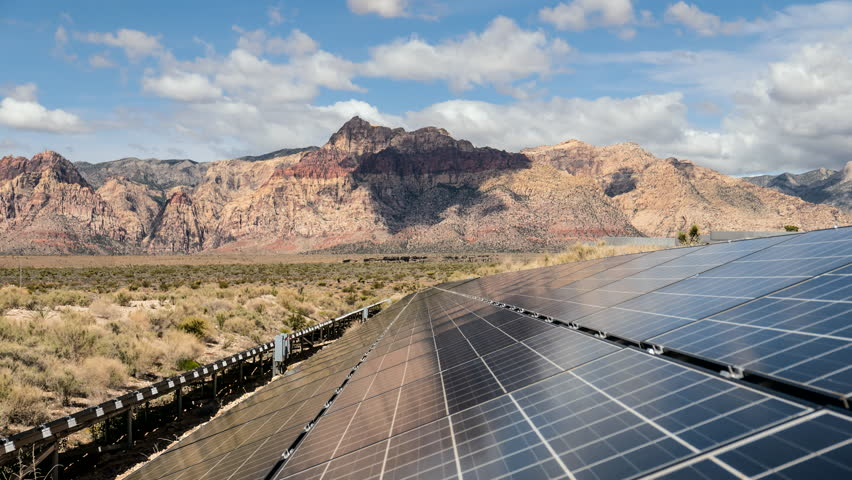 Solar energy panels with Mojave desert clouds time lapse at Red Rock Canyon National Conservation Area in Southern Nevada.