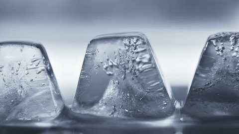 Thawing ice cube close-up timelapse 4k (4096x2304)