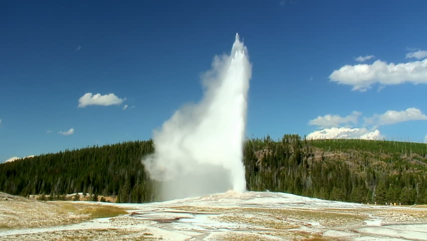 Old Faithful geyser erupting in Yellowstone National Park