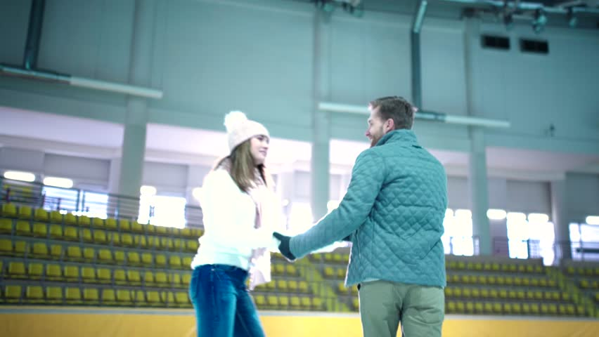 Smiling young couple at skating rink | Shutterstock HD Video #16520704