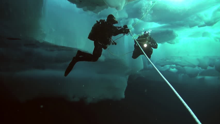 Unique extreme underwater shooting scuba dive beneath ice at geographic  North Pole in cold waters. Fantastic views of the lump of ice in water. ICE CAMP BARNEO, NORTH POLE, ARCTIC - APRIL 2015 | Shutterstock HD Video #16524145