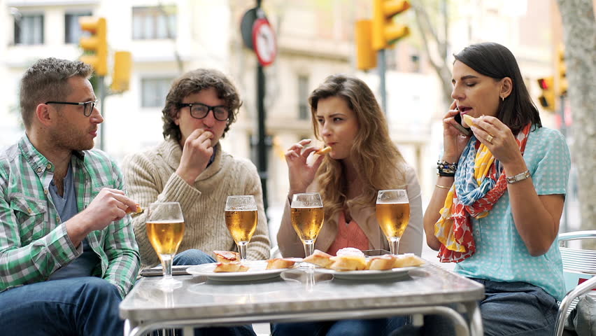 Group of friends having lunch in the cafe and talking on cellphone  | Shutterstock HD Video #16542535