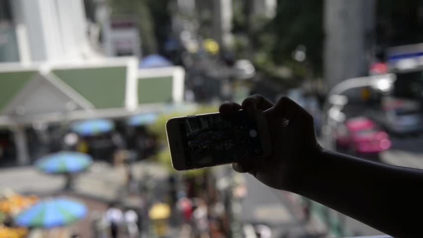 Silhouette of Unknown man taking a photo via smartphone in city of Bangkok,Thailand  | Shutterstock HD Video #16548730