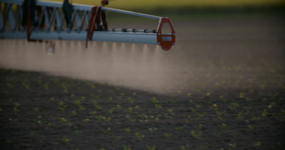 Tractor spray fertilize on field with chemicals in agriculture field. Royalty-Free Stock Footage #16559230
