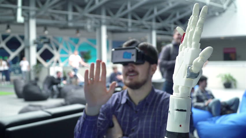 Cybernetic system today. Game industry and motion tracking in cyberspace. Man with innovative spectacles creates movement for mechanical plastic arm. Printing on the 3D printer. Sci Fi and prosthetics | Shutterstock HD Video #16566610