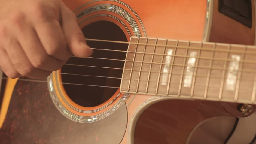 Guitar close up of fingers on strings in an audio music recording studio   Shutterstock HD Video #16572400