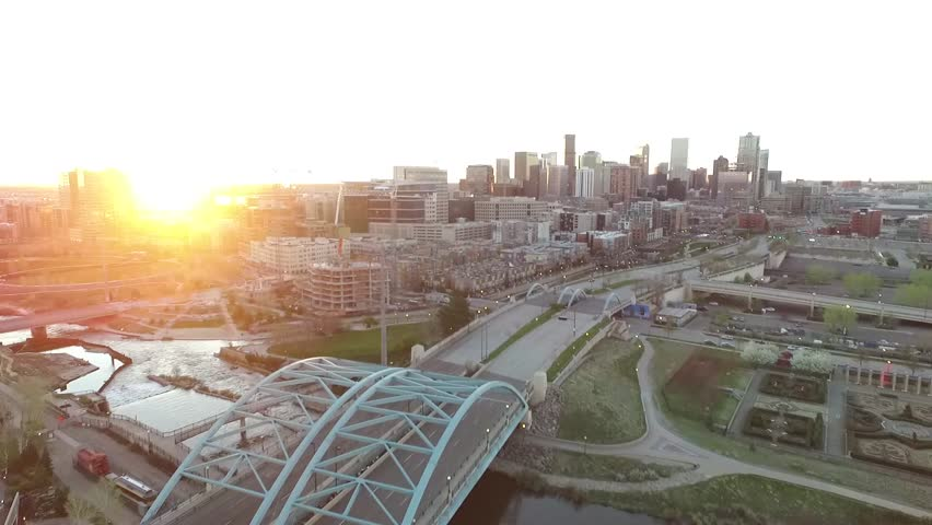 Aerial Drone Footage of Downtown Denver at Sunrise over Platt River and Speer Bridge