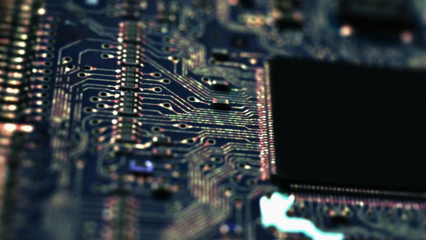 Circuit Board / Processor Chips / Data Streams. Macro tracking over circuit board with conceptual image of the red-green electrical signals flowing in electrical conductors. (av28163c) Royalty-Free Stock Footage #16591057