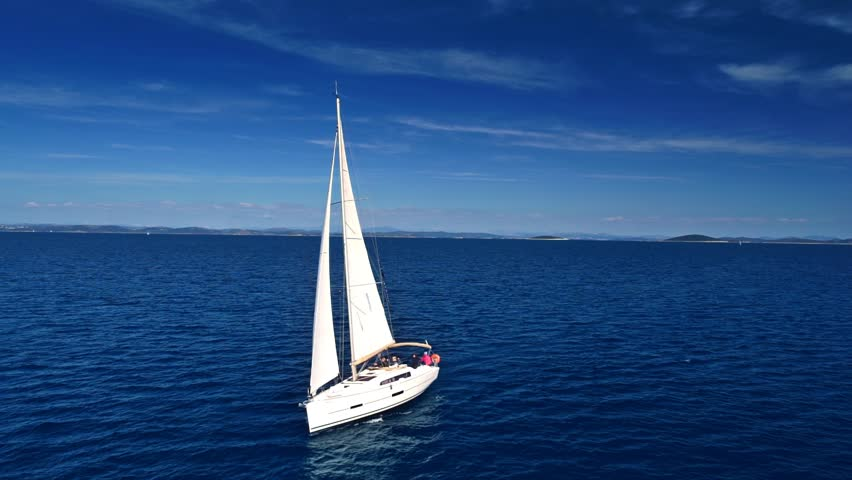 Yacht sailing on open sea at sunny day. Yachting. Yacht video. Yacht drone video. Sailing video. Sailing boat. Sailing aerial video. Sailing yacht. | Shutterstock HD Video #16596526